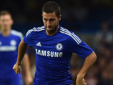 """Chelsea's Belgian midfielder Eden Hazard runs with the ball during the pre-season football friendly match between Chelsea and Real Sociedad at Stamford Bridge in London on August 12, 2014. AFP PHOTO/BEN STANSALL RESTRICTED TO EDITORIAL USE. NO USE WITH UNAUTHORIZED AUDIO, VIDEO, DATA, FIXTURE LISTS, CLUB/LEAGUE LOGOS OR """"LIVE"""" SERVICES. ONLINE IN-MATCH USE LIMITED TO 45 IMAGES, NO VIDEO EMULATION. NO USE IN BETTING, GAMES OR SINGLE CLUB/LEAGUE/PLAYER PUBLICATIONS."""