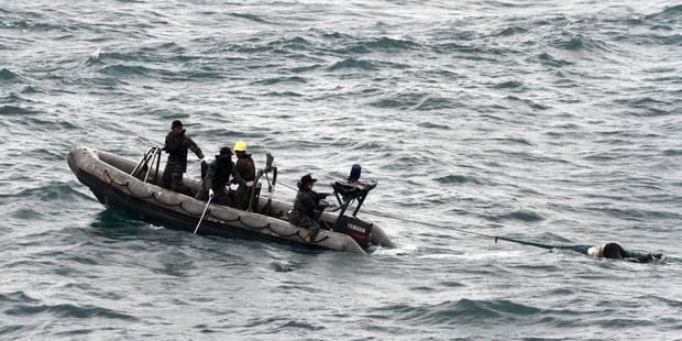 """Disparition d'un avion d'AirAsia: la météo est le """"facteur déclenchant"""" du crash - La DH"""