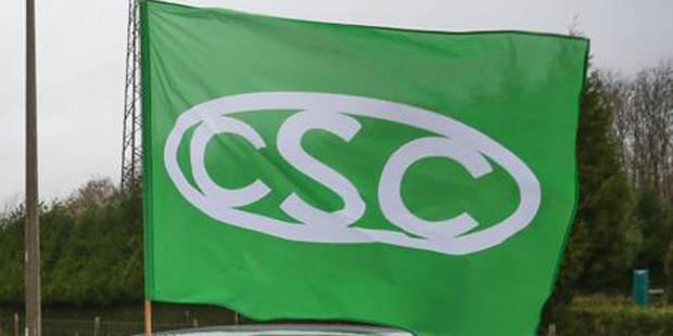 La CSC et la FGTB ont fait pleuvoir les billets de 20.000 euros à Liège - La DH