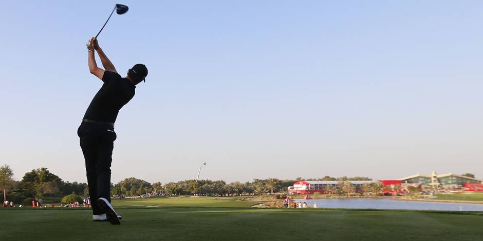 Thomas Pieters of Belgium plays a shot during the final of the Abu Dhabi Golf Championship in the capital of the United Arab Emirates on January 24, 2016. / AFP / KARIM SAHIB