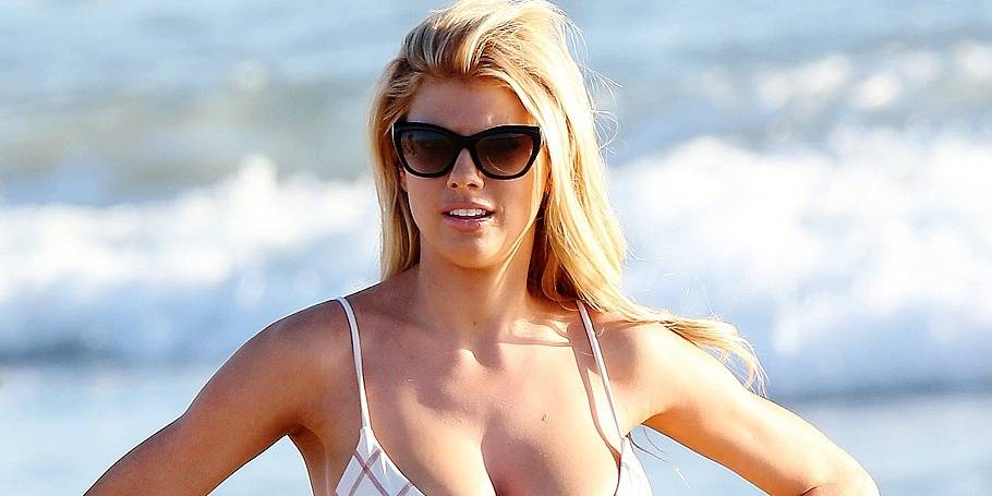 EXCLUSIVE: Carl's Jr babe Charlotte McKinney and her dance partner Keo Motsepe filming Dancing with the stars on Santa Monica beach