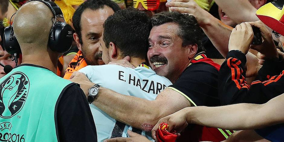 Eden Hazard of Belgium is mobbed by fans at full time during the UEFA EURO EM Europameisterschaft Fu
