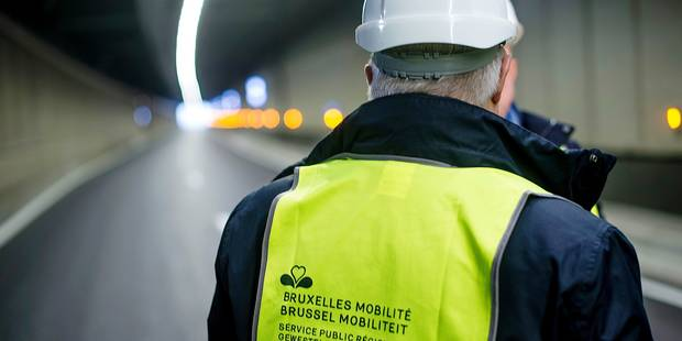 Illustration shows a yellow vest of brussels mobility (Bruxelles mobilite - Brussel mobiliteit) on Brussels region Minister of Finance, Budget and External relations Guy Vanhengel at a press visit to the renovated 'Tunnel Montgomery - Montgomerytunnel' tunnel in Brussels, Thursday 08 December 2016, which is scheduled to reopen this month. BELGA PHOTO FILIP DE SMET